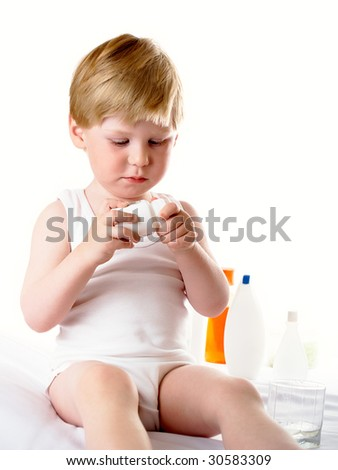 The boy accepts tablets from female hands - stock photo