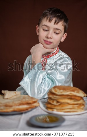 the boy and is a lot of pancakes  - stock photo