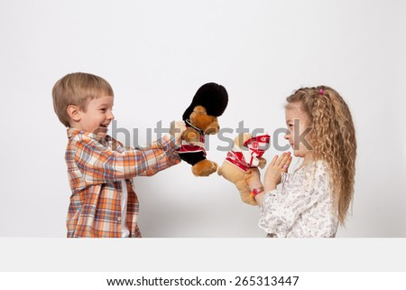 The boy and the girl play and quarrel - stock photo