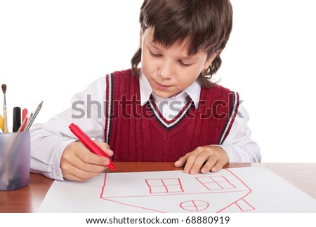 The boy draws the house on a paper - stock photo