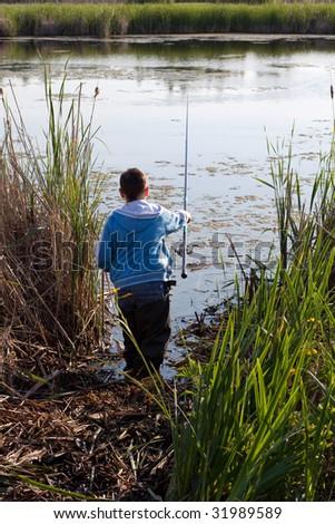 The boy fisherman - stock photo