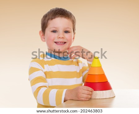 The boy gathered piece.passionate child for interesting occupation,active lifestyle,happiness concept,carefree childhood concept. - stock photo