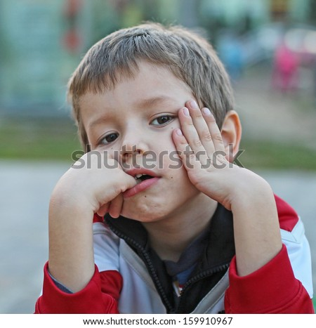 The boy gazes - stock photo