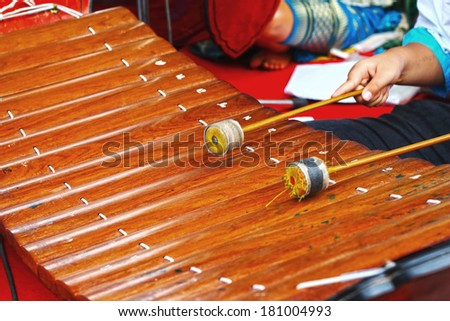 The boy hit the xylophone instrument Thailand - stock photo