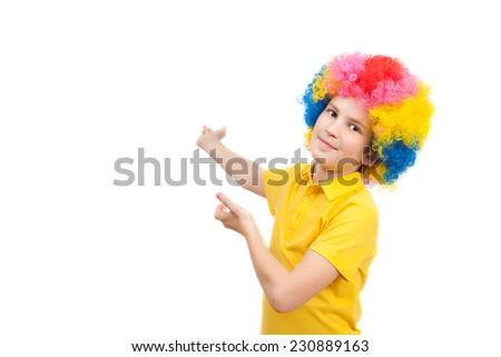 the boy in the bright multi-colored wig - stock photo