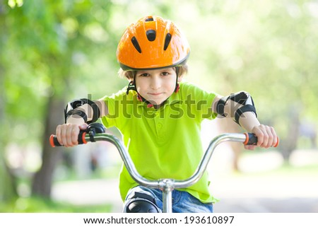 the boy in the protective helmet for bike - stock photo