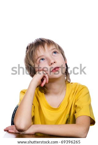 The boy looks upwards and dreams - stock photo