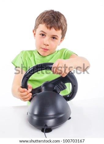 The boy plays a computer game with the help joystick - stock photo