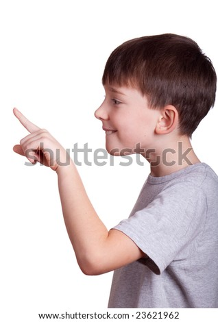 The boy pointing a finger at something. The boy pressing on the imaginary button. - stock photo