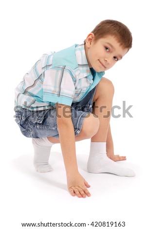 The boy poses, isolated on white background - stock photo