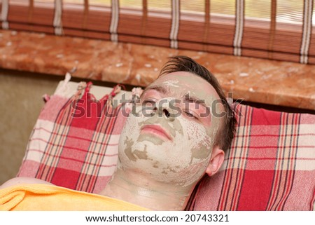 The boy under the mask in beauty salon - stock photo
