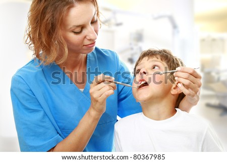 The boy with a doctor in a dental surgery. - stock photo