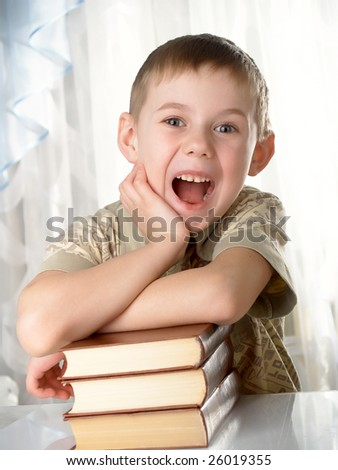 The boy with books on the white background - stock photo