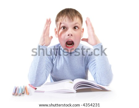 The boy with the book behind a table on a white background - stock photo