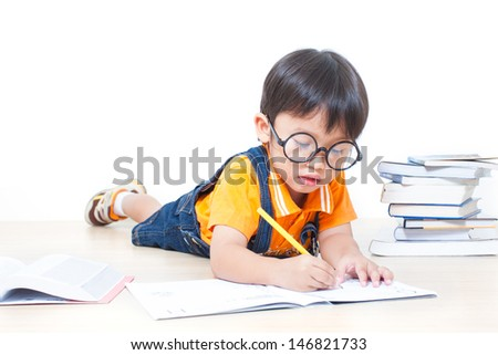 The boy writing homework from school in workbook  - stock photo