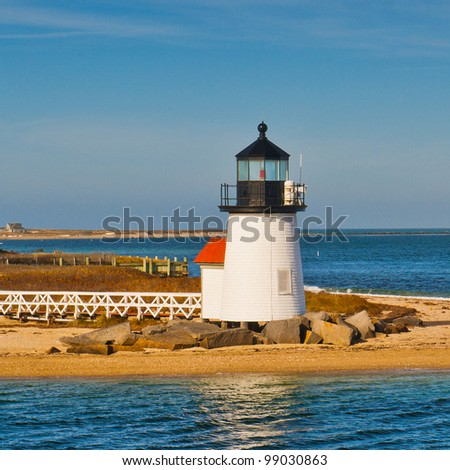 The Brant Point Lighthouse at the entrance to Nantucket Harbor. It is the shortest lighthouse in New England. - stock photo