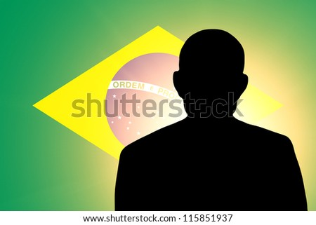 The Brazilian flag and the silhouette of an unknown man - stock photo