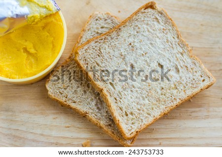 The bread is sliced into thin pieces. - stock photo