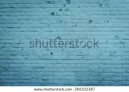 The brick texture with cracks and scratches can be used as a background - stock photo