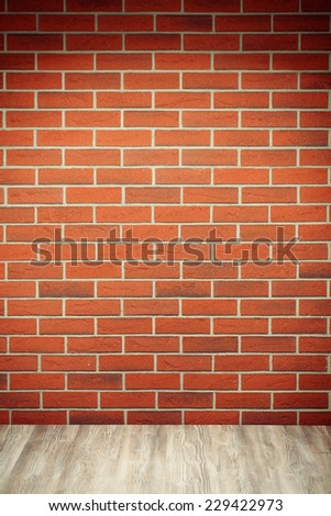 the brick wall and wooden floor - stock photo