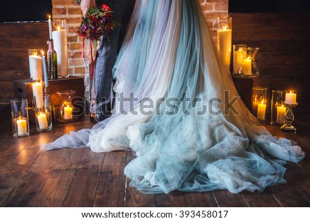 The bride and groom at a wedding ceremony by candlelight, part. - stock photo