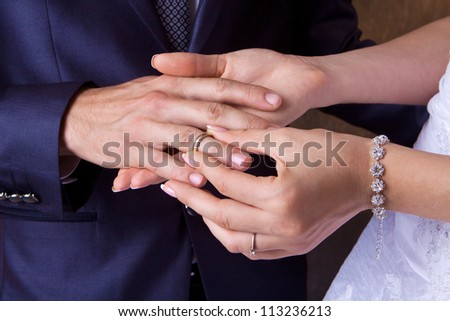 The bride dresses a wedding ring to the husband - stock photo