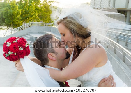 The bride kisses the groom - stock photo