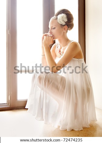 The bride thought the window - stock photo