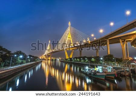 The Bridge across the river at twilight in Samutprakarn province Thailand - stock photo