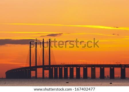 The bridge between Denmark and Sweden with Copenhagen in the background - stock photo