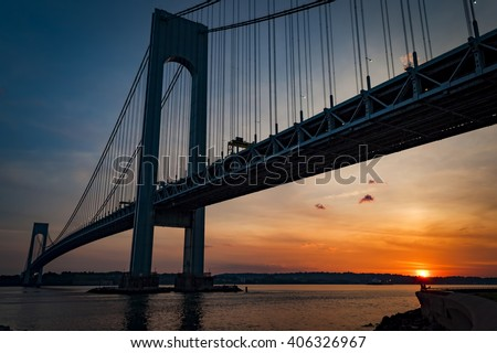 The bridge connecting Brooklyn to Staten Island named Verrazano bridge seen at dusk - stock photo