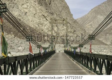 The bridge crossing the river in Ladakh, India - stock photo