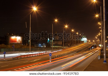 The bridge of a traffic interchange at night. Kyiv, Ukraine - stock photo