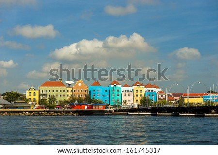 The brightly painted buildings in the harbor of Willemstad - stock photo