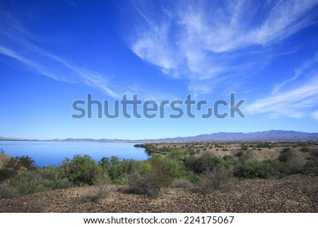 The brilliant blue sky reflects into the waters of Lake Havasu in Arizona, USA. - stock photo