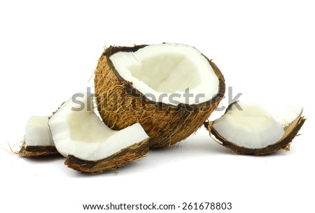 the broken coconut (isolated object on white background) - stock photo