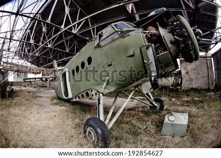 The broken down remains of an old abandoned Navy plane  - stock photo