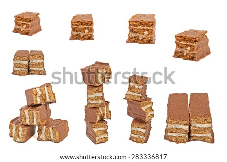 The broken pieces of chocolate biscuit isolated on white - stock photo