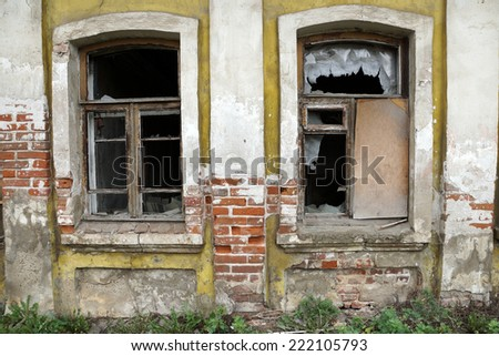 the broken windows of the old house - stock photo