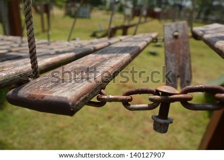 The broken wooden bridge in kids playground outdoor park - stock photo