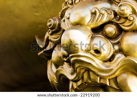 The bronze lion guardian China temple Chonburi Thailand - stock photo