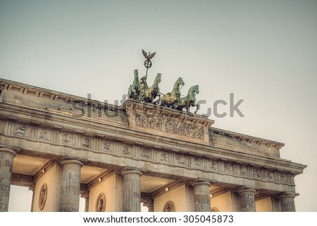 the bronze sculpture Quadriga on top of the Brandenburg Gate, Berlin, Germany, Europe, vintage style - stock photo