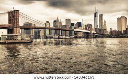 The Brooklyn Bridge and Lower Manhattan skyline seen from Brooklyn Bridge Park. - stock photo