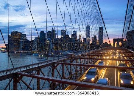 The Brooklyn Bridge and skyline of New York City at sunset - stock photo