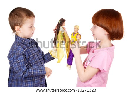 The brother and sister play dolls - stock photo