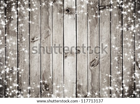 the brown wood texture with white snow and stars. Christmas background - stock photo