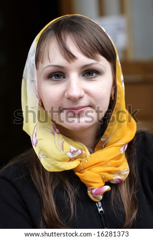 The brunette happy girl with orange kerchief - stock photo