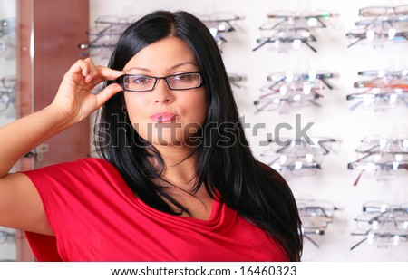 the brunette tries glasses - stock photo