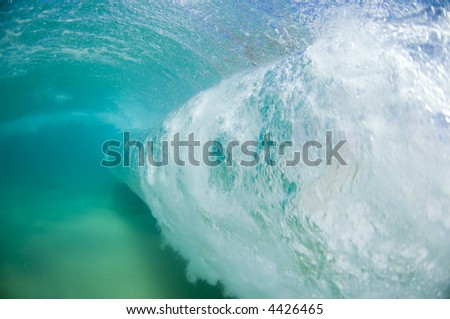 the bubbles of a giant wave underwater - stock photo