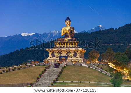 The Buddha Park of Ravangla and star treks sky on background at night, it is situated near Rabong in South Sikkim district, Sikkim, India - stock photo